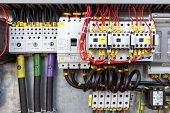 stock photo of electric station  - Electrical panel with fuses and contactors cables - JPG