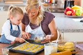 stock photo of nibbling  - Baking with the family  - JPG