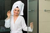 image of douching  - Young woman in the hotel bathroom - JPG