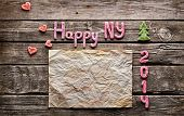 Sweet 2014 New Year holiday background. With old crumpled paper, small hearts and cute small Christm