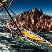 stock photo of brigantine  - Pirate brigantine out on sea - JPG