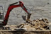 picture of dozer  - the excavator working on a construction site - JPG