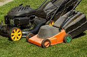 image of grass-cutter  - two lawnmower in the garden lawn the grass  - JPG