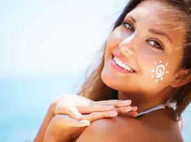 picture of sun tan lotion  - Suntan Lotion Woman Applying Sunscreen Solar Cream - JPG