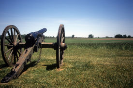 stock photo of rebs  - Napoleon 12 lb cannon Confederate lines Civil War battlefieldGettysburg National Battlefield ParkPennsylvania  - JPG