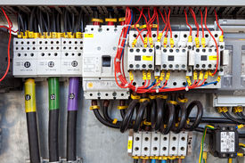 stock photo of contactor  - Electrical panel with fuses and contactors cables - JPG