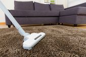 stock photo of suction  - Vacuum cleaner on carpet - JPG