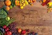 stock photo of ingredient  - studio photography of different fruits and vegetables on old wooden table - JPG