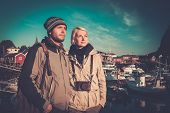 pic of reining  - Young travellers couple in Reine village - JPG