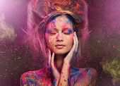 stock photo of alien  - Young woman muse with creative body art and hairdo - JPG