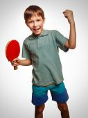 stock photo of ping pong  - table tennis athlete ping pong boy experiencing joy of victory winning success emotions gray - JPG