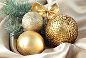 Beautiful Christmas decor on golden satin cloth