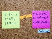 picture of interpreter  - famous Confucius quote interpretation with sticker notes on cork board - JPG