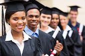 stock photo of multicultural  - group of multicultural university graduates standing in a row - JPG