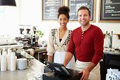 stock photo of cash register  - Male Owner Of Coffee Shop - JPG