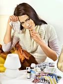 picture of home remedy  - Woman with remedy having  flue in bed - JPG