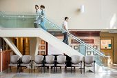 foto of staircases  - Side view of medical team and man using staircase in hospital - JPG