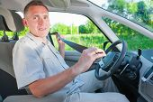 image of seatbelt  - Man driver with seatbelt in hand - JPG