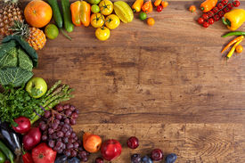 stock photo of nutrients  - studio photography of different fruits and vegetables on old wooden table - JPG