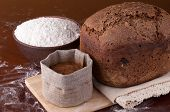 picture of malt  - Fresh bread with flour and malt on the table - JPG