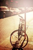 stock photo of bicycle gear  - Bicycle resting at the street - JPG