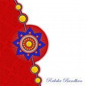 picture of rakhi  - Beautiful colorful rakhi on floral design decorated red and grey background on the occasion of Happy Raksha Bandhan celebrations - JPG