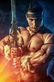 foto of sword  - Portrait of a handsome muscular ancient warrior with a sword - JPG