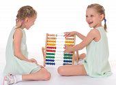 stock photo of montessori school  - Cute sisters work in the Montessori environment - JPG