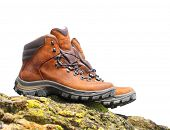 stock photo of boot camp  - Hiking boots on the rock with space for your text - JPG