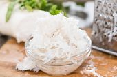 foto of grated radish  - Fresh grated Horseradish on dark wooden background - JPG