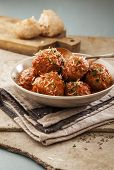 image of meatballs  - Meatballs cooked in tomato sauce in bowl on grey backround - JPG