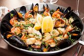 picture of valencia-orange  - seafood paella in the fry pan - JPG