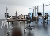 stock photo of movable  - Contemporary minimalist office interior with workstations set up on a movable table and a floor - JPG