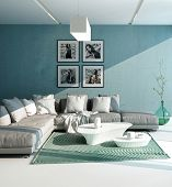 pic of aquamarine  - Comfortable contemporary lounge interior with a close up view of an upholstered grey suite with cushions against an aquamarine wall with artwork - JPG