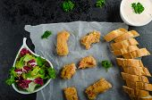 stock photo of endive  - Salmon in herb batter with spicy dressing  - JPG
