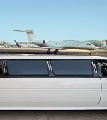 image of strip  - white limousine and private jet on landing strip - JPG