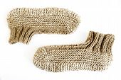stock photo of budge  - Traditional Bulgarian knitted slippers isolated on white - JPG