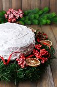 picture of desert christmas  - Christmas cake with wreath on wooden background - JPG