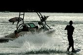 stock photo of ski boat  - Wakeboarder on the water at dusk