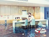 image of accident emergency  - beautiful woman sitting on a chair in flooded kitchen interior - JPG