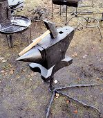 stock photo of anvil  - forge anvil on Christmas market with big hammer - JPG