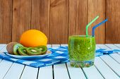 stock photo of light weight  - Healthy homemade kiwi juice in glass and fresh orange - JPG
