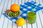 foto of light weight  - Healthy homemade kiwi juice in glass and fresh orange - JPG