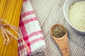 stock photo of oregano  - Close up of spaghetti and other ingredients - JPG