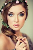 stock photo of flower girl  - Beautiful girl with a wreath of flowers on her head - JPG