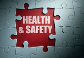 pic of fire insurance  - Missing pieces from a jigsaw puzzle revealing health and safety - JPG
