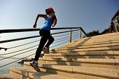 pic of stepping stones  - healthy lifestyle sports woman running up on stone stairs sunrise seaside - JPG