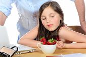 image of envy  - a little girl looking the strawberries with envy - JPG