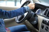 foto of driver  - young asian woman driver driving a car - JPG