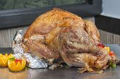image of buffet  - Closeup of roasted turkey on display at a restaurant buffet carvery - JPG